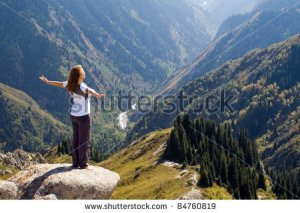 stock-photo-yoga-at-summit-with-aerial-view-of-the-mountain-range-84760819